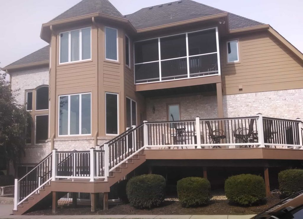 Deck Builders in Columbus Ohio created a beautiful, brown and white composite deck in the backyard of a home