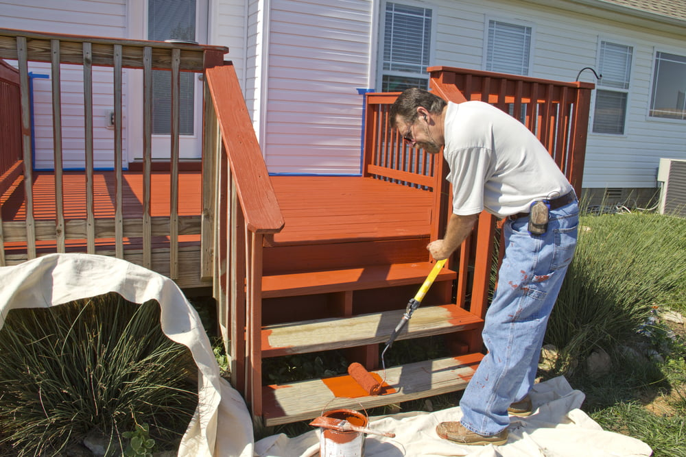 Painting a pressure-treated wood deck in Columbus, Ohio